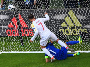 Spain's forward Alvaro Morata (L) opens the scoring for his team during the Euro 2016 group D football match between Croatia and Spain at the Matmut Atlantique stadium in Bordeaux on June 21, 2016. / AFP PHOTO / MEHDI FEDOUACH