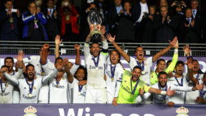 TRONDHEIM, NORWAY - AUGUST 09: Sergio Ramos of Real Madrid lifts the trophy after his team's victory during the UEFA Super Cup match between Real Madrid and Sevilla at Lerkendal Stadion on August 9, 2016 in Trondheim, Norway. (Photo by Michael Steele/Getty Images)